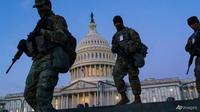 Pasukan Garda Nasional memperkuat zona keamanan di Capitol Hill di Washington pada 19 Januari 2021, sehari sebelum Presiden terpilih Joe Biden dilantik sebagai presiden ke-46 Amerika Serikat. (Foto: AP / J. Scott Applewhite)