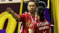 Pelatih kepala tunggal putri pelatnas PBSI, Edwin Iriawan, resmi mengundurkan diri per Juni 2015. (Bola.com/PBSI)