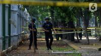 Anggota Gegana Brimob Polri melakukan penjagaan di sekitar lokasi ledakan di kawasan Monas, Jakarta, Selasa (3/12/2019). Dalam ledakan itu dua anggota TNI menjadi korban dan mengalami luka. (merdeka.com/Imam Buhori)