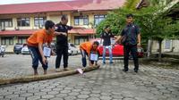 Rekontruksi pembunuhan calon pendeta cantik di Kabupaten OKI Sumsel digelar di Polda Sumsel (Liputan6.com / Nefri Inge)