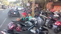 Parkir di Kota Malang menyeret seorang pejabat Dishub Kota Malang sebagai tersangka dugaan korupsi (Liputan6.com/Zainul Arifin)