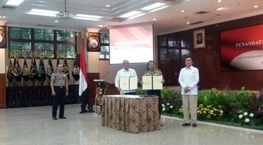 Polri bersama dengan BPH Migas dan SKK Migas menandatangani nota kesepahaman (Liputan6.com/Nanda)
