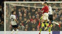 Gol-gol Setan Merah dicetak oleh Marcus Rashford, Harry Maguire  dan sang megabintang Cristiano Ronaldo yang mengantarkan MU menutup laga dengan kemenangan 3-2. (AP/Dave Thompson)