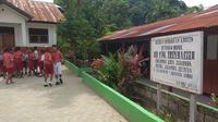 Pemkot Jayapura baru memberlakukan kembali aktifitas belajar mengajar di sekolah, pasca rusuh Jayapura seminggu lalu. (Liputan6.com/Katharina Janur)