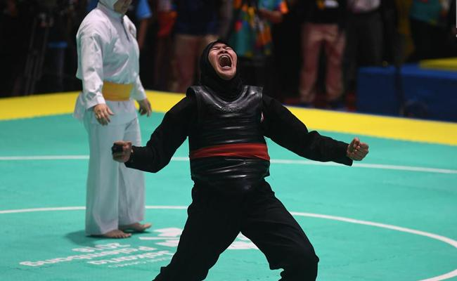 Pipiet yang melakukan selebrasi setelah memenangkan pertandingan/copyright Merdeka.com/Imam Buhori