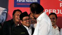 Cak Imin dan Surya Paloh saling berpelukan saat menghadiri koalisi mendukung Joko Widodo sebagai calon presiden, Lenteng Agung, Jakarta, Rabu (14/05/2014) (Liputan6.com/Johan Tallo).