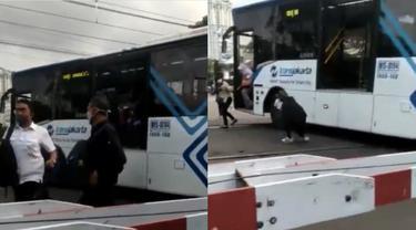 Viral Video Bus Transjakarta Mogok di Tengah Perlintasan KRL, Warga Berjibaku Mendorong