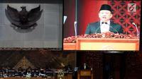 Ketua DPR Bambang Soesatyo berpidato dalam Rapat Paripurna ke-19 di Kompleks Parlemen, Senayan, Jakarta, Senin (5/3). Rapat ini diwarnai sejumlah interupsi dari anggota DPR. (Merdeka.com/Iqbal Nugroho)