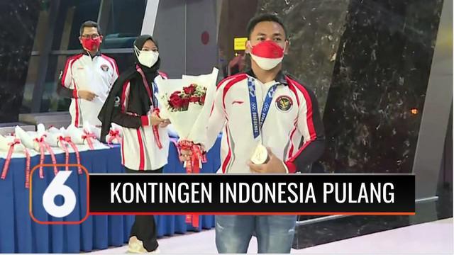 Kepulangan kloter pertama atlet kontingen Indonesia dari Olimpiade Tokyo 2020 disambut Menteri Pemuda dan Olahraga Zainudin Amali di Terminal 3 VIP Bandara Internasional Soekarno Hatta.