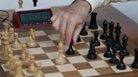Ilustrasi pertandingan catur (BILL GREENBLATT / AFP)