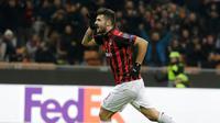 Pemain AC Milan, Patrick Cutrone melakukan selebrasi usai mencetak gol ke gawang F-91 Dudelange dalam laga kelima Grup F Liga Europa di Stadion San Siro, Milan, Italia, Kamis (29/11). AC Milan menang 5-2. (AP Photo/Luca Bruno)