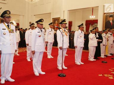 Sembilan gubernur dan wakil gubernur hasil Pilkada 2018 diambil sumpahnya saat pelantikan di Istana Negara, Jakarta, Rabu (5/9). Pelantikan dilakukan langsung oleh Presiden Joko Widodo atau Jokowi. (Liputan6.com/HO/Wan)