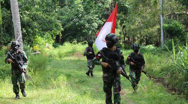 Prajurit TNI berpatroli di perbatasan RI-PNG, di Papua. (Foto: Liputan6.com/Dok. Kostrad)