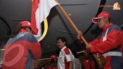 Roy Suryo (Menpora - tengah) memimpin langsung upacara pengukuhan dan pelepasan 621 atlit yang akan berlaga di Sea Games 2013 Myanmar di Jakarta pada 2 Desember 2013 (Liputan6.com/Helmi Fithriansyah)