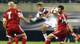 PERINGKAT II -  Gelandang serang Jerman, Thomas Muller berada pada peringkat kedua deretan pencetak gol terbanyak pada kualifikasi Piala Eropa 2016 dengan sembilan gol dari sembilan pertandingan. (AFP Photo/Tobias Schwarz)