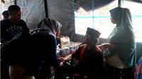 Pemerintah Kabupaten Bolaang Mongondow (Bolmong)memberikan pemdampingan kepada keluarga korban longsor Pertambangan Emas Tanpa Izin (PETI) Bakan, Kecamatan Lolayan, Kabupaten Bolmong, Sulawesi Utara. (Liputan6.com/Yoseph Ikanubun)