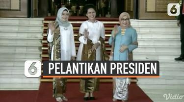 Ibu Negara Iriana Jokowi berjalan bersama dengan Mufidah Jusuf Kalla dan Wury Ma'ruf Amin ke dalam sidang paripurna untuk menyaksikan Pelantikan Presiden dan Wakil Presiden periode 2019-2024.