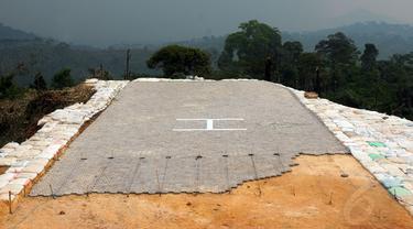 Sebuah helipad dibangun di salah satu sisi Gunung Padang di Kampung Cimanggu, Cianjur, Jawa Barat, (20/9/2014). (Liputan6.com/Helmi Fithriansyah)