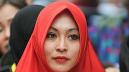 Terpidana kasus suap Wisma Atlet Hambalang, Angelina Sondakh yang kini berhijab, di Rutan Pondok Bambu, Jakarta Timur. (Liputan6.com/Yoppy Renato)