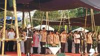 Presiden Jokowi menghadiri peringatan Hari Pramuka ke-58 di Lapangan Utama Bumi Perkemahan Wiladatika Cibubur Jakarta Timur. (Liputan6.com/Lizsa Egeham)