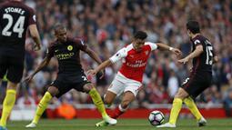 Setan Merah dikabarkan menggelontorkan dana 35 juta pounds untuk memboyong pemain tersebut dari Arsenal. (AFP/Adrian Dennis)