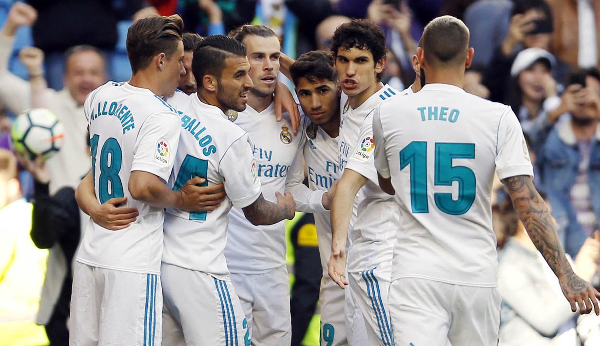 Para pemain Real Madrid merayakan kemenangan atas Leganes pada laga La Liga di Santiago Bernabeu, Sabtu (28/4/2018). Real Madrid menang 2-1 atas Leganes. (AP/Francisco Seco)