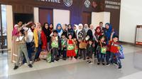 Para pekerja migran Indonesia (PMI) dan anak-anak WNI.