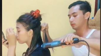 Aksi Pria Bantu Catok Rambut Istri dengan Telaten Tuai Pujian Warganet