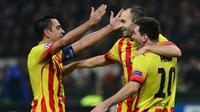 Trio pemain lulusan akademi La Masia milik Barcelona, Xavi Hernandez, Andres Iniesta, dan Lionel Messi. (AFP/Giuseppe Cacace)