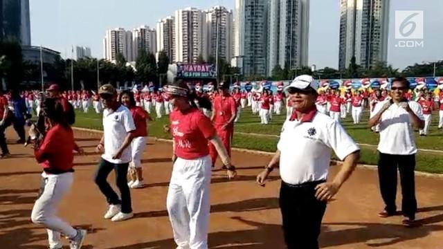 Kepala KSP dan Menaker menghadiri perayaan May Day yang diadakan di GOR Soemantri, Jakarta.
