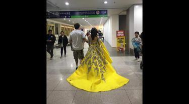 Inilah cerita di balik sebuah video viral yang memperlihatkan seorang perempuan yang mengenakan gaun kuning berdansa dengan seorang pria. (Screenshot Facebook)
