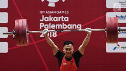 Eko Yuli menambah emas kelima di Asian Games 2018, setelah menjadi juara di kelas 62 kilogram putra dan meraih medali emas dengan total angkatan 311 kilogram. (merdeka.com/Imam Buhori)