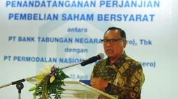 Dirut PT BTN, Maryono memberi sambutan saat acara penandatanganan perjanjian pembelian saham bersyarat PNMIM dari PNM di Kementerian BUMN, Jakarta, Senin (22/4). Melalui penandatangan tersebut, Bank BTN membeli 33.000 lembar saham PNMIM senilai Rp114,3 miliar milik PNM. (Liputan6.com/Angga Yuniar)