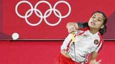Wakil Indonesia, Gregoria Mariska Tunjung, berhasil memastikan satu tempat di babak perempat final bulutangkis nomor tunggal putri Olimpiade Tokyo 2020, Rabu (28/7/2021). (Foto: AFP/Alexander Nemenov)