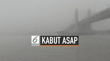 Sungai Musi hari ini diselimuti kabut asap hingga menutupi jarak pandang. Akibatnya nelayan tidak bisa menangkap ikan karena jarak pandang yang pendek.