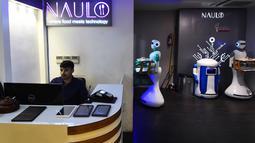 Dalam gambar yang diambil pada 26 Oktober 2018, pelayan robot bernama Ginger mengantarkan makanan untuk pelanggan di restoran Naulo di Kathmandu. Robot pelayan ini merupakan yang pertama ada di Nepal. (Prakash MATHEMA/AFP)