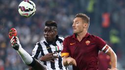 Paul Pogba. Hanya memperkuat satu tim di Serie A yaitu Juventus setelah dilepas Manchester United pada awal musim 2012/2013. Total 4 musim bersama Juventus tampil dalam 178 laga di semua ajang dengan mencetak 34 gol. (AFP/Marco Bertorello)