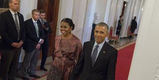 Berakhirnya masa kepemimpinan Presiden Barrack Obama berarti berakhir juga status Michelle Obama sebagai Ibu Negara. Ia pun bercerita soal perasaannya ketika harus meninggalkan White House. (AFP/Bintang.com)