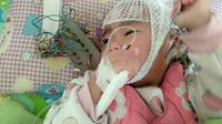 Ayah bekerja sebagai badut untuk biayai pengobatan anaknya (Sumber: Shanghai.ist)