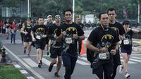 Para pelari beradu cepat saat mengikuti Batman Run Series di Jakarta Barat, Minggu (1/12). Acara ini merupakan kerjasama antara Indofunrun dengan Lippo Mall Puri. (Dokumentasi Indofunrun)