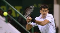 Novak Djokovic (KARIM JAAFAR / AL-WATAN DOHA / AFP)