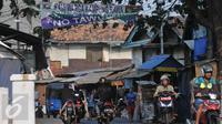 Suasana jelang Idul Adha di kawasan Johar Baru, Jakarta (23/9/2015). Petugas Resort Johar Baru akan mengamankan kawasan yang menjadi tempat tawuran antara Kampung Rawa dan Tanah Tinggi 12 (Liputan6.com/Gempur M Surya)