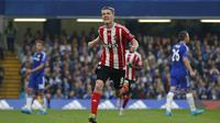 Davis merayakan gol ke gawang Chelsea (Reuters)