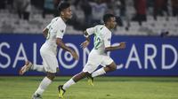 Gelandang Timnas Indonesia, Todd Rivaldo, merayakan gol yang dicetaknya ke gawang Qatar pada laga AFC U-19 Championship di SUGBK, Jakarta, Minggu (21/10). Indonesia kalah 5-6 dari Qatar. (Bola.com/Vitalis Yogi Trisna)