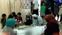 Novy, warga yang tewas saat menyentuh kabel listrik di dalam rumahnya saat banjir.