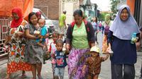 Dinas Kesehatan (Dinkes) Kota Surabaya menggelar kegiatan Timbang Serentak di Posyandu yang tersebar se-Surabaya, Rabu (12/2/2020).  (Foto: Liputan6.com/Dian Kurniawan)