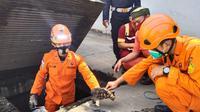 Basarnas Selamatkan Kucing Yang Terjebak Di Gorong-gorong Pelabuhan Merak, Kota Cilegon, Banten. (SJumat, 26/02/2021). (Dokumentasi Basarnas Banten).