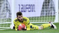 De Gea benar-benar berperan krusial dalam menjaga gawangnya agar tak kebobolan lebih banyak. Kiper asal Spanyol itu tercatat melakukan 10 kali penyelamatan. (Foto: AFP/Filippo Monteforte)