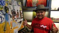 Kenobi, bocah penyandang autisme, menggelar pameran lukisan perdananya di Butik Tirana House Yogyakarta. (Liputan6.com/Switzy Sabandar)