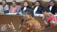 Kepala Kejati DKI Jakarta, Sudung Situmorang dan Asisten Tindak Pidana Khusus, Tomo Sitepu hadir sebagai saksi dalam sidang kasus suap petinggi PT Brantas Abipraya di Pengadilan Tipikor, Jakarta, Rabu (3/8). (Liputan6.com/Immanuel Antonius)